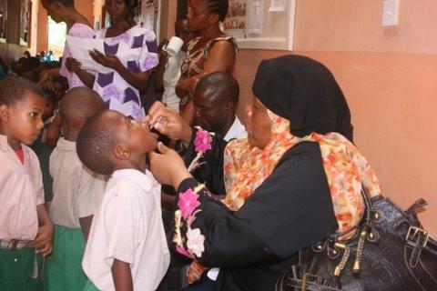 Nurse providing polio vaccination